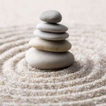 about karma - image of rocks balanced on sand